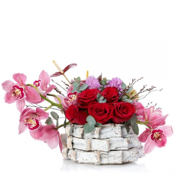 Floral arrangement in basket with cymbidium and hyacinths