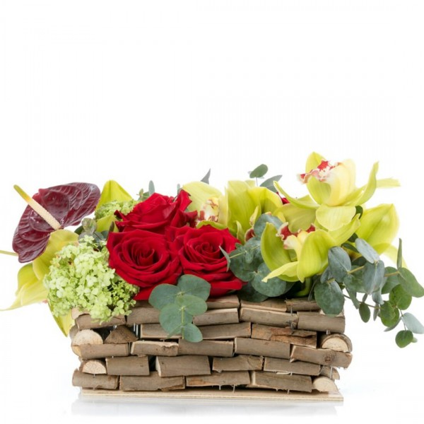 Floral arrangement in basket with hyacinths and orchids