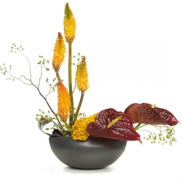 Floral arrangement with rosehips and anthurium