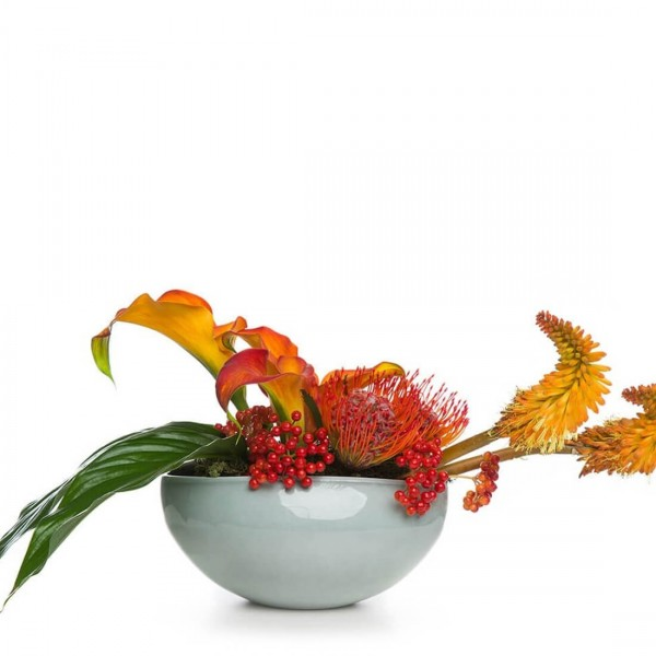 Floral arrangement with track and kniphofia uvaria