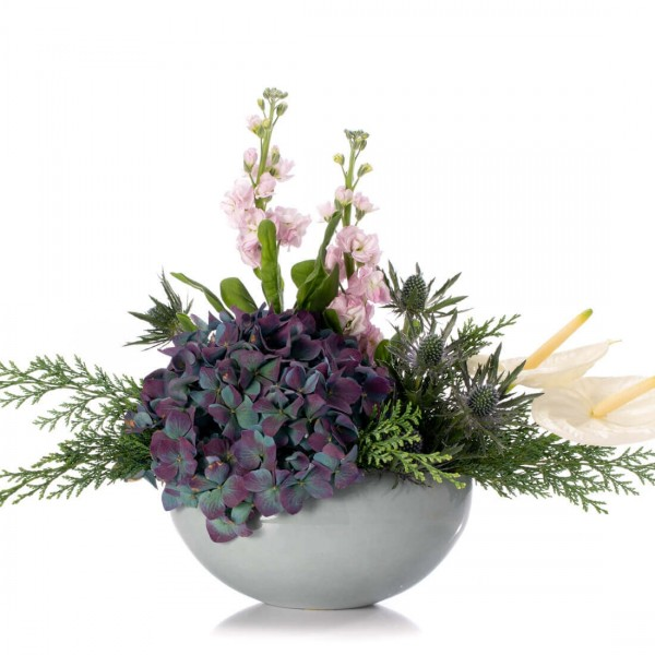 Floral arrangement with white anthurium and blue hydrangea