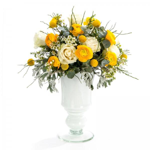 Wedding floral arrangement of roses, ranunculus