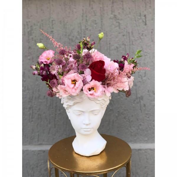 Arrangement With Antirrhinum And Lisiantus In Vase Statue Woman
