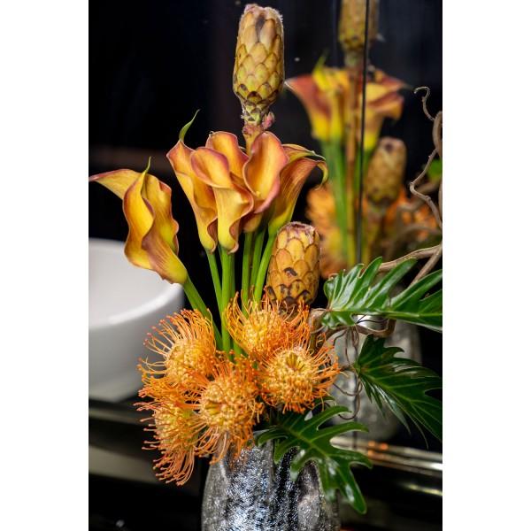 Protea and calla floral arrangement