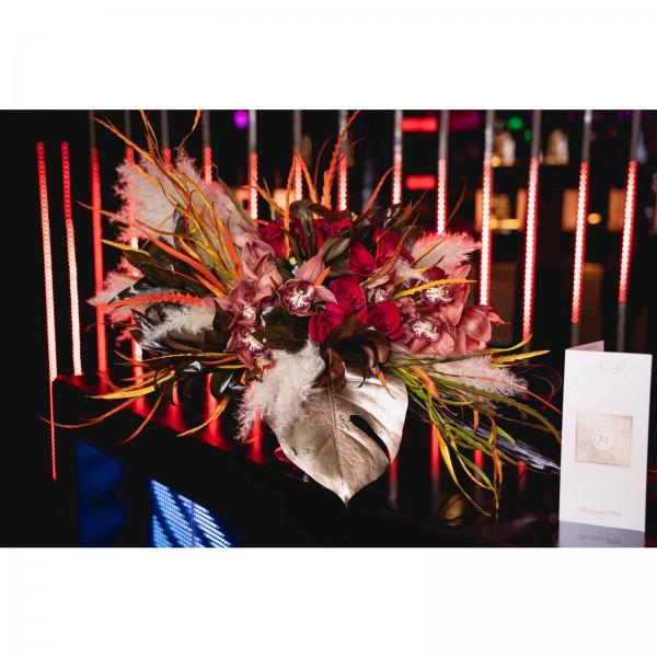 Floral arrangement cymbidium cognac