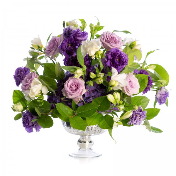 Wedding floral arrangement of freesias, roses
