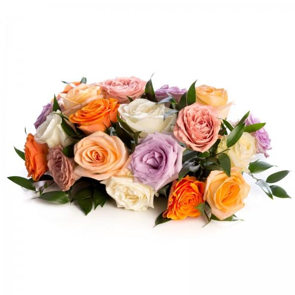 Floral arrangement of peach, purple, orange, white, cappuccino roses