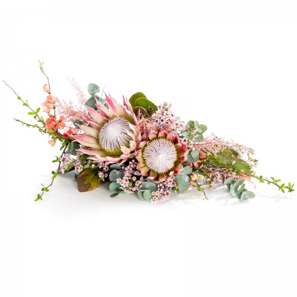 Protea and waxflower presidium arrangement