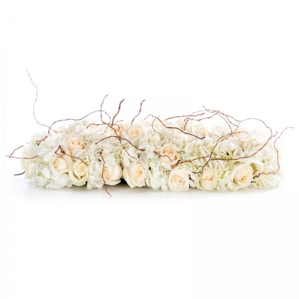 Presidium arrangement of cream roses and white hydrangeas