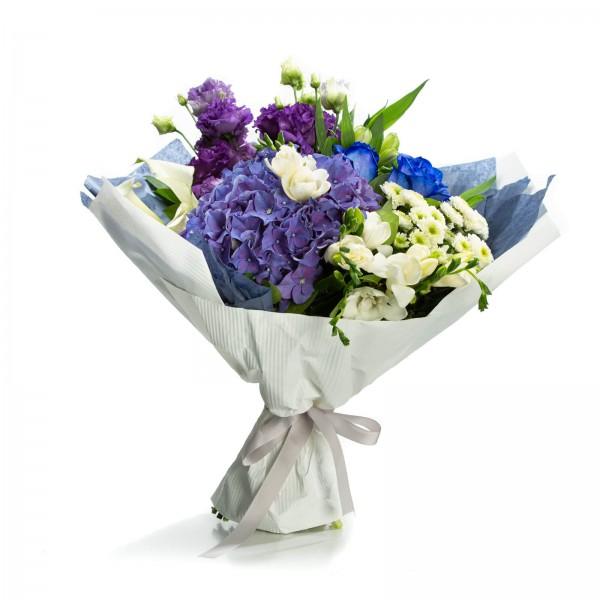 Bouquet of purple hydrangeas and white freesias