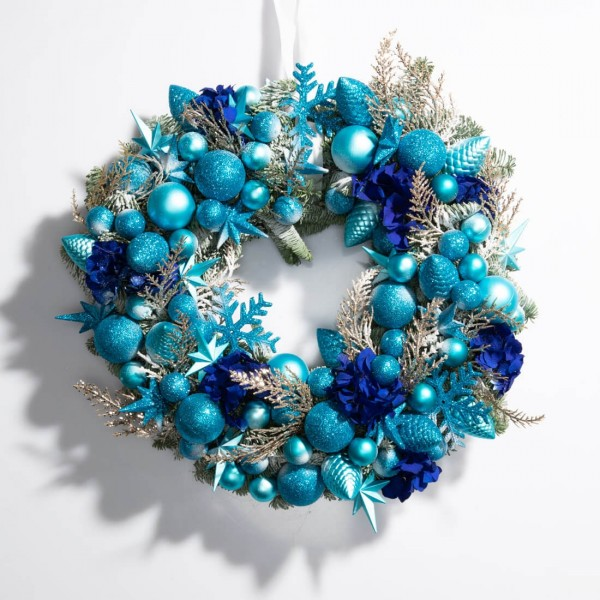 Christmas wreath made of natural fir and blue globes