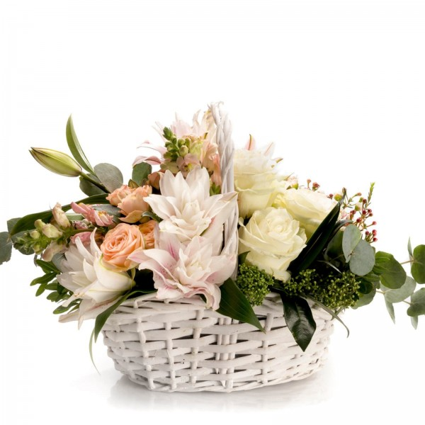 Floral arrangement in basket with mini rose and waxflower