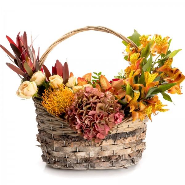 Floral arrangement in basket with cream mini rose