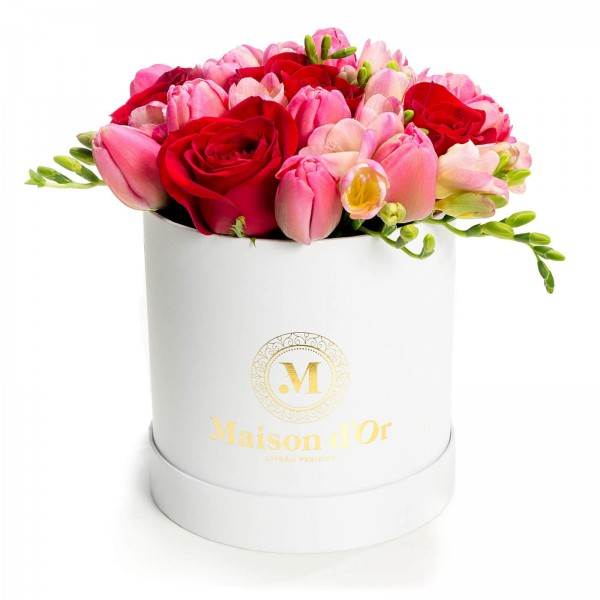 Box of tulips and pink freesias