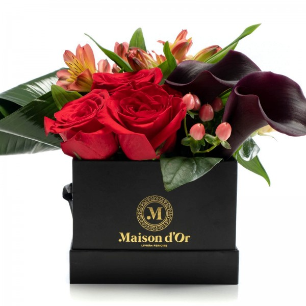 Box with red roses and alstroemeria
