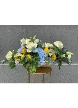 Floral arrangement with hydrangea, white roses and lemons
