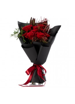Bouquet of flowers with red roses and leucadendron