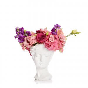 Arrangement with hydrangea and lisiantus in the female statue vase