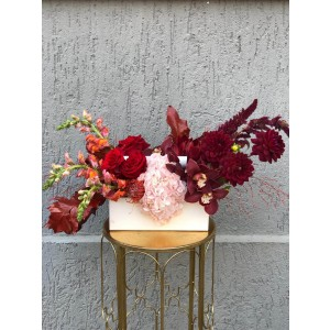 Floral Arrangement In Basket With Amaryllis, Dahlia And Cymbidium