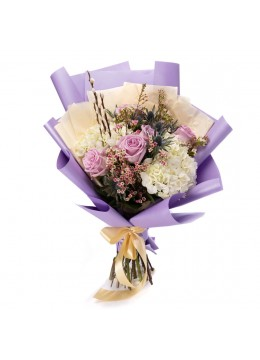 Bouquet of flowers with white hydrangeas and lilac roses