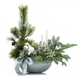 Floral arrangement with fir, white candles and decorative elements