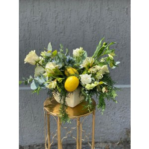 Floral arrangement with hydrangea, roses, lemons and lisianthus