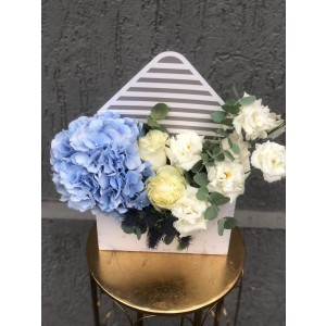 Floral Arrangement In Box Envelope with hydrangea, lisianthus and eryngium