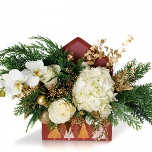 Christmas floral arrangement with white roses and gold accesories