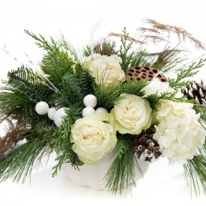 Floral arrangement with roses, cones, fir and hydrangea