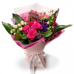 Bouquet of flowers with cyclamen roses and mini rose