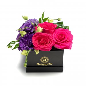 Box with cyclamen roses and purple lisianthus