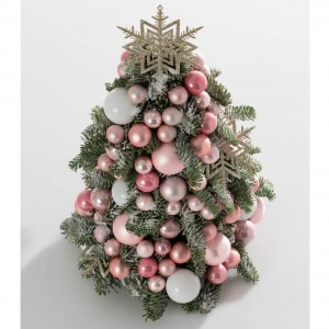 Christmas tree decorated with pink balls
