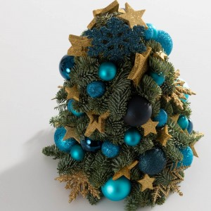 Christmas tree decorated with blue globes and golden stars