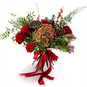 Bouquet of flowers with hydrangea, red roses and holly
